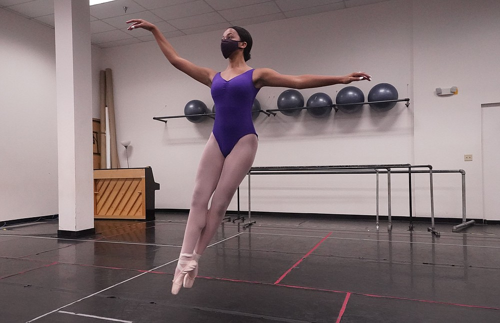 """Ballet student Micah Sparrow dances in a classroom at the Texas Ballet Theatre, Wednesday, Oct. 7, 2020, in Fort Worth, Texas. For many, it's not Christmas without the dance of Clara, Uncle Drosselmeyer, the Sugar Plum Fairy, the Mouse King and, of course, the Nutcracker Prince. But this year the coronavirus pandemic has canceled performances of """"The Nutcracker"""" around the U.S. and Canada, eliminating a major and reliable source of revenue for dance companies already reeling financially following the essential shutdown of their industry.  (AP Photo/LM Otero)"""