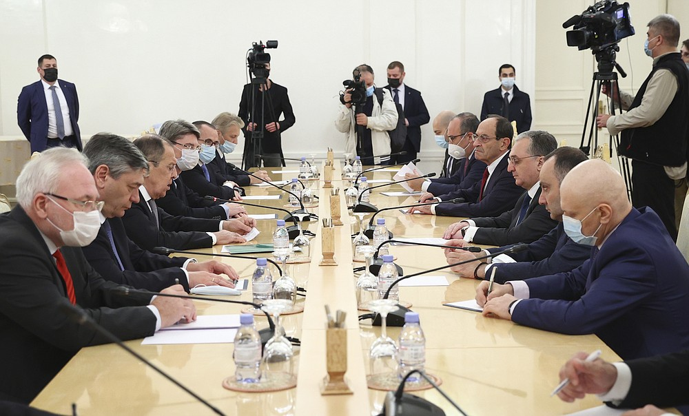 In this photo released by Russian Foreign Ministry Press Service, Russian Foreign Minister Sergei Lavrov, third from left, meets with Armenia's Foreign Minister Zohrab Mnatsakanyan in Moscow, Russia, Monday, Oct. 12, 2020. (Russian Foreign Ministry Press Service via AP)