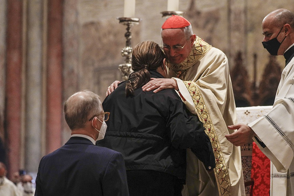 Cardinal Agostino Vallini (right) embraces the mother of the 15-year-old Carlo Acutis, who is on his way to becoming the first millennial to be recognized as a saint in the Roman Catholic Church, during the boy's beatification last week at Assisi, Italy's St. Francis Basilica. (AP/Gregorio Borgia)