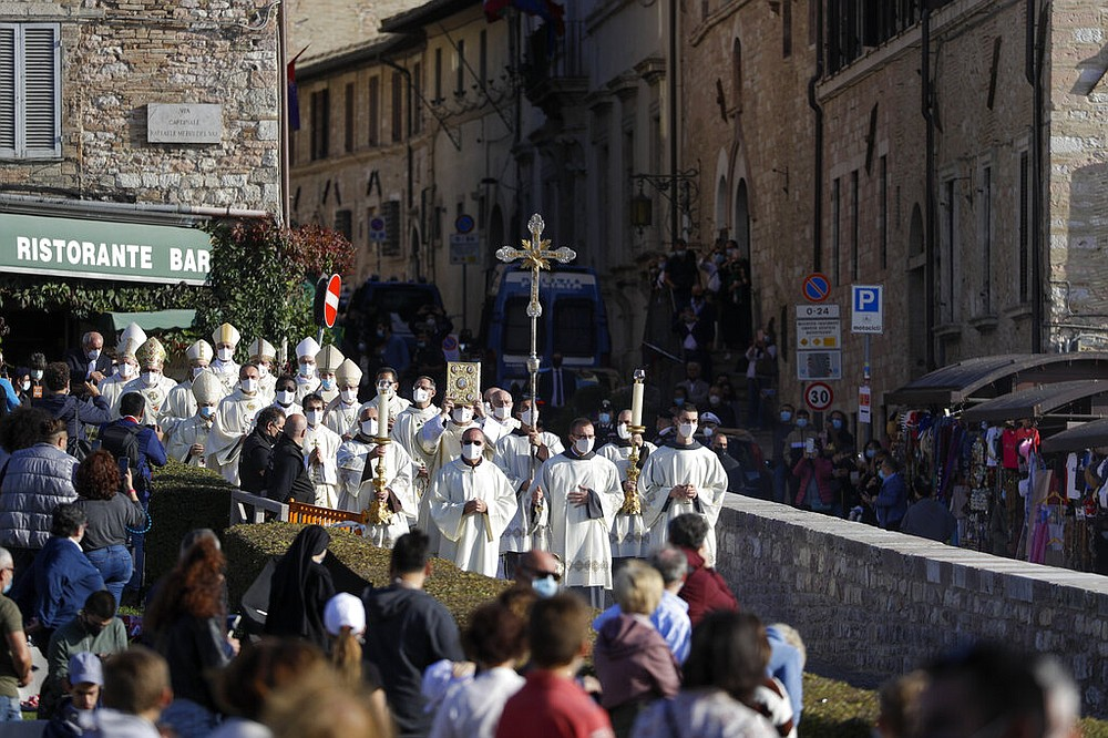 A procession walks through the streets of Assisi, Italy, prior to the beatification ceremony of 15-year-old Carlo Acutis, an Italian boy who died in 2006 of leukemia, Saturday, Oct. 10, 2020. (AP Photo/Gregorio Borgia)