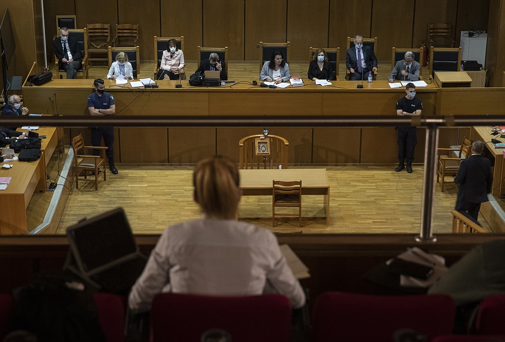 A vioew of the court during the sentencing announcement of the Golden Dawn trial, in Athens, Wednesday, Oct. 14, 2020. The court has sentenced the leadership of Greece's extreme-right Golden Dawn party to 13 years in prison, imposing the near-maximum penalty for running a criminal organization blamed for numerous violent hate crimes. The landmark ruling follows a five-year trial of dozens of top officials, members, and supporters of Golden Dawn, an organization founded as a Neo-Nazi group in the 1980s, that rose to become Greece's third-largest political during a major financial crisis in the previous decade.(AP Photo/Petros Giannakouris)