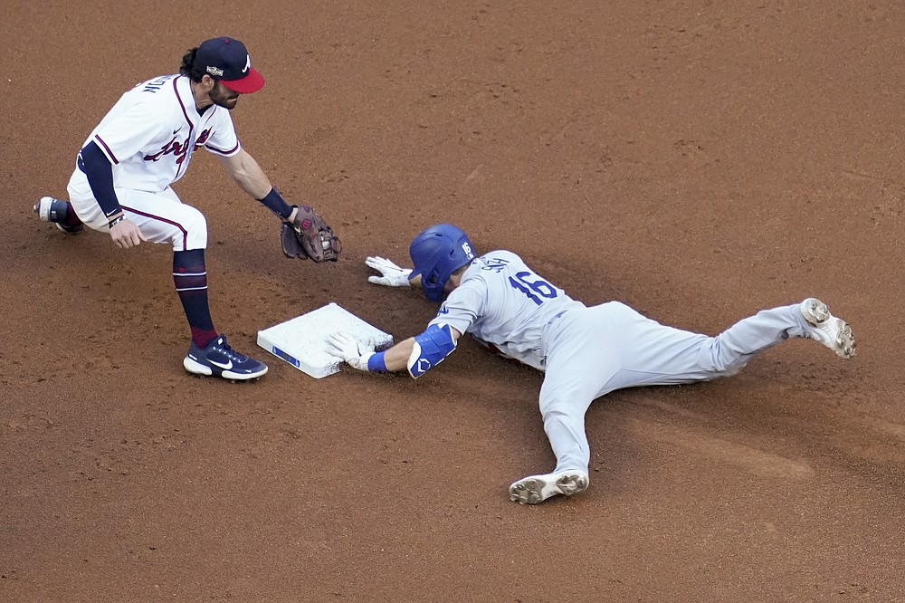 Los Angeles Dodgers' Will Smith is safe at second past Atlanta Braves shortstop Dansby Swanson after a double during the first inning in Game 3 of a baseball National League Championship Series Wednesday, Oct. 14, 2020, in Arlington, Texas. (AP Photo/David J. Phillip)