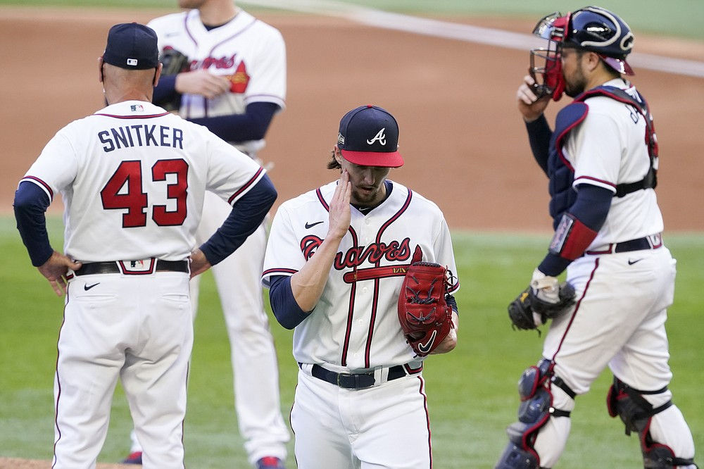 Atlanta Braves starting pitcher Kyle Wright is taken out of the game against the Los Angeles Dodgers during the fourth5 inning in Game 3 of a baseball National League Championship Series Wednesday, Oct. 14, 2020, in Arlington, Texas. (AP Photo/Tony Gutierrez)