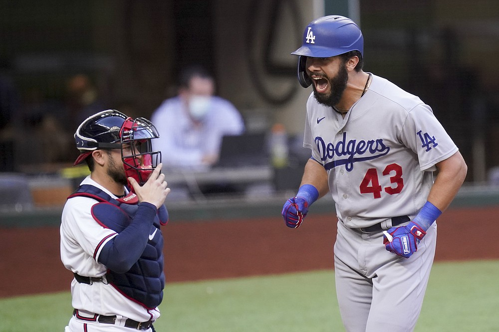 Los Angeles Dodgers Edwin Rios celebrates his home run against the Atlanta Braves during the first inning in Game 3 of a baseball National League Championship Series Wednesday, Oct. 14, 2020, in Arlington, Texas. (AP Photo/Eric Gay)