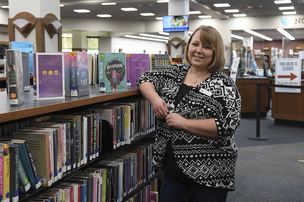 Young adult librarian Brittany Chavez, shown in the young adult section of the Garland County Library on Wednesday, recently received the Ann Lightsey Children's Librarian Award. - Photo by Grace Brown of The Sentinel-Record