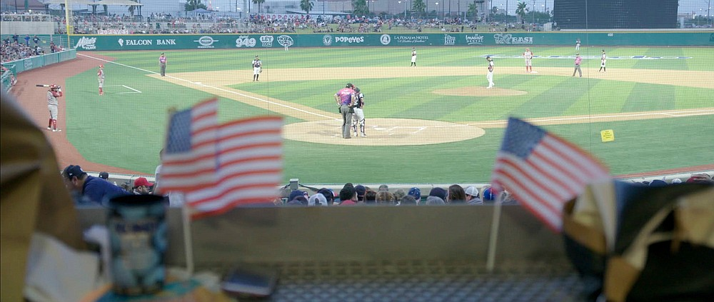 """A 2019 game of Tecolotes de los Dos Laredo, a binational professional baseball team with home stadiums in Nuevo Laredo, Mexico, and Laredo, Texas, appears in a scene from """"Bad Hombres."""" The new Showtime sports documentary follows this AAA Mexican League baseball team that plays on both sides of the U.S.-Mexico border amid the tension around migration, divisive politics, and environmental concerns. (Showtime via AP)"""