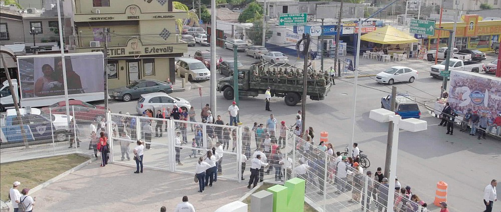 """A Mexican military truck with soldiers patrol the baseball stadium in Nuevo Laredo, Mexico, during a 2019 home game of e Tecolotes de los Dos Laredo, a binational professional baseball team with home stadiums in Nuevo Laredo and Laredo, Texas. """"Bad Hombres,"""" a new Showtime sports documentary, follows this AAA Mexican League baseball team that plays on both sides of the U.S.-Mexico border amid the tension around migration, divisive politics, and environmental concerns. (Showtime via AP)"""