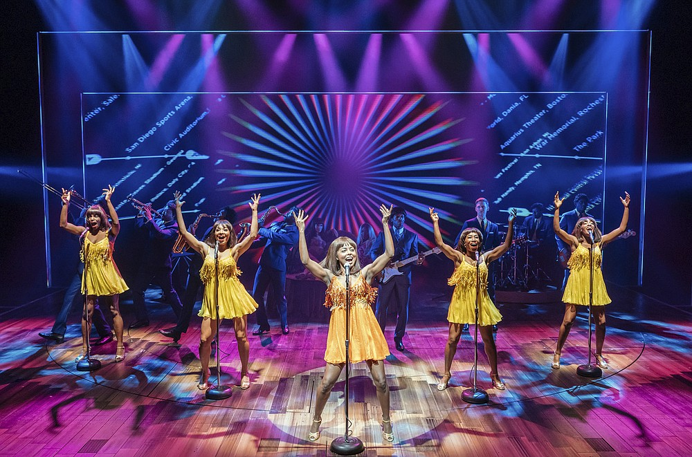 """This image released by Polk & Co. shows Adrienne Warren, center, during a performance of """"Tina: The Tina Turner Musical."""" Nominations for Tony Awards will be announced Thursday with just 18 eligible plays and musicals making the cut, a fraction of the 34 shows the season before. (Manuel Harlan/Polk & Co. via AP)"""