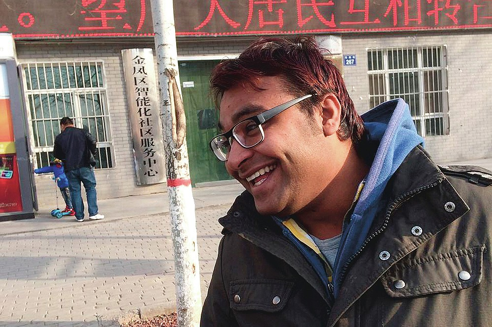 In this Dec. 23, 2014, photo Joginder Chaudhary smiles after completing a clinical class at Ningxia Medical University in Yinchuan, China. After the virus killed the 27-year-old Chaudhary in late July 2020, his mother wept inconsolably. With her son gone, Premlata Chaudhary said, how could she go on living? Three weeks later, on Aug. 18, the virus took her life, too — yet another number in an unrelenting march toward a woeful milestone. (Courtesy of Aravind Kumar via AP)