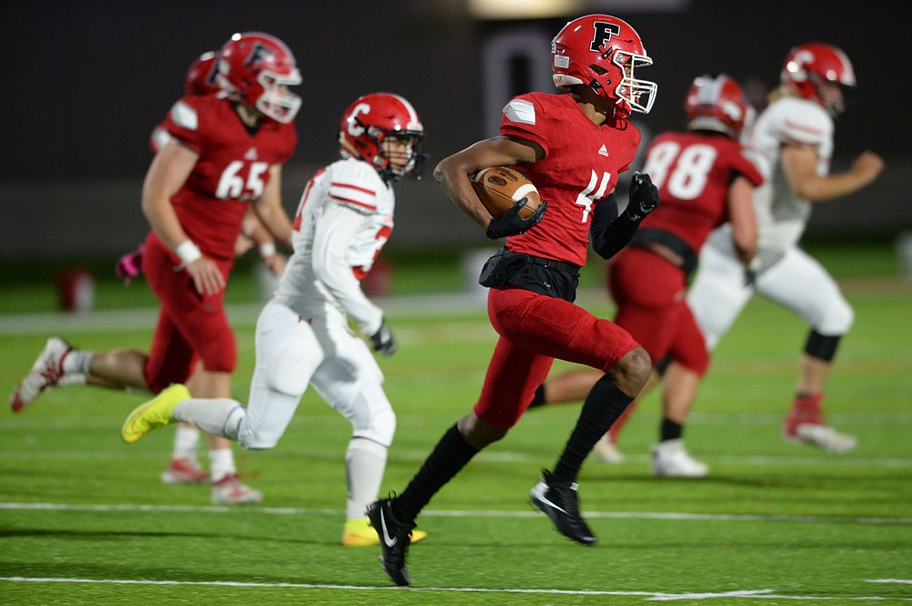 Farmington's Devonte Donovan (4) carries the ball Friday, Oct. 16, 2020, through the Clarksville defense during the first half of play at Cardinal Stadium in Farmington. Visit nwaonline.com/201017Daily/ for today's photo gallery.  (NWA Democrat-Gazette/Andy Shupe)