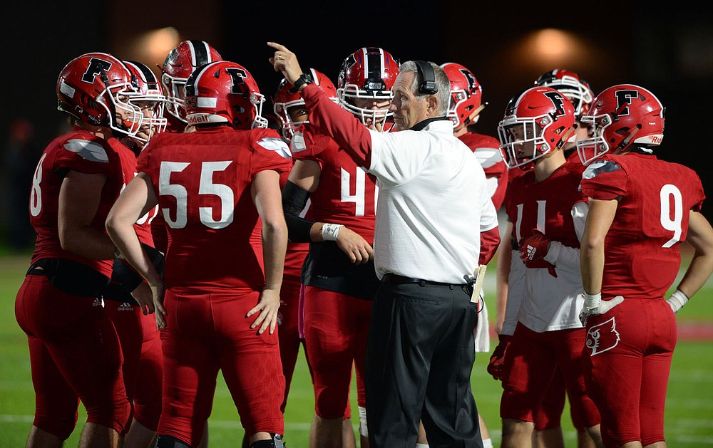 Farmington coach Mike Adams speaks to his team Friday, Oct. 16, 2020, during the first half of play against Clarksville at Cardinal Stadium in Farmington. Visit nwaonline.com/201017Daily/ for today's photo gallery.  (NWA Democrat-Gazette/Andy Shupe)