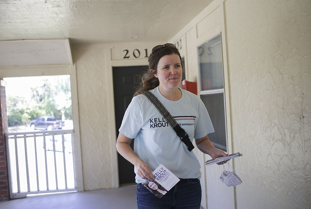 Kelly Krout drops off info cards as she campaigns, Friday, October 16, 2020 at The Links apartment complex in Lowell. Krout is running in the House district 90 race in Rogers/Lowell. Check out nwaonline.com/2010018Daily/ for today's photo gallery.  (NWA Democrat-Gazette/Charlie Kaijo)