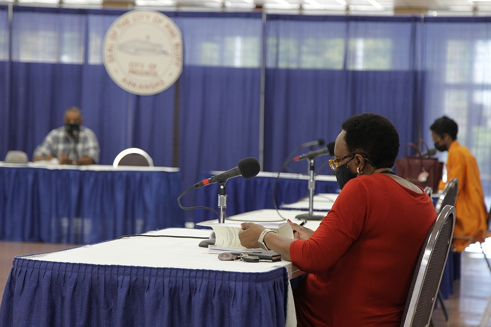 Louise Sullivan, foreground, assistant to Mayor Shirley Washington, goes over the particulars of a new solid waste contract being proposed between the city and Waste Management of Arkansas, with Public Health and Welfare Committee members Ivan Whitfield, left, and Joni Alexander, right. The issue goes to the full council Monday night. Some council members have favored giving the council more time to study the issue or to give time for public comment, but with the old contract set to expire Oct. 31, there is pressure to get the new agreement ratified. A big concern expressed by council members is past customer service problems with Waste Management. (Pine Bluff Commercial/Dale Ellis)