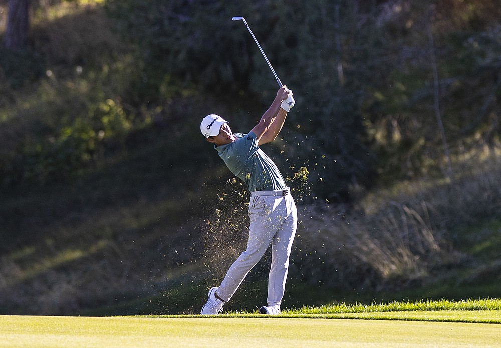 Collin Morikawa hits on the ninth hole during the second round of the CJ Cup golf tournament at the Shadow Creek Golf Course, Friday, Oct. 16, 2020, in North Las Vegas. (Chase Stevens/Las Vegas Review-Journal via AP)