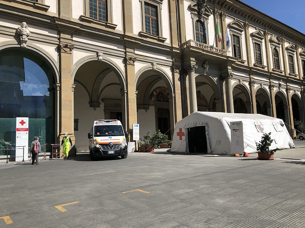 Outside Santa Maria Nuova Hospital, a tent is set up for screening potential coronavirus patients. MUST CREDIT: Washington Post photo by Chico Harlan.