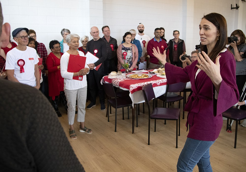 New Zealand Prime Minister Jacinda Ardern gestures as she thanks her electorate workers at an event in Auckland, New Zealand, Saturday, Oct. 17, 2020. New Zealand is holding a general election Saturday, and opinion polls indicate Ardern is on track to win a second term as prime minister. (AP Photo/Mark Baker)