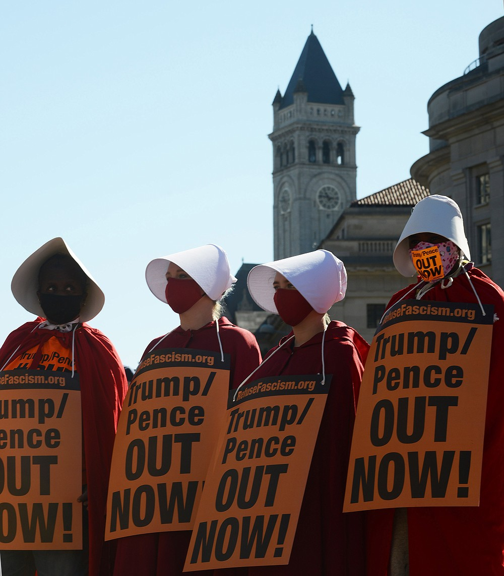 Women dressed as handmaidens to protest Supreme Court nominee Amy Coney Barrett on Oct. 17, 2020. MUST CREDIT: photo for The Washington Post by Astrid Riecken.
