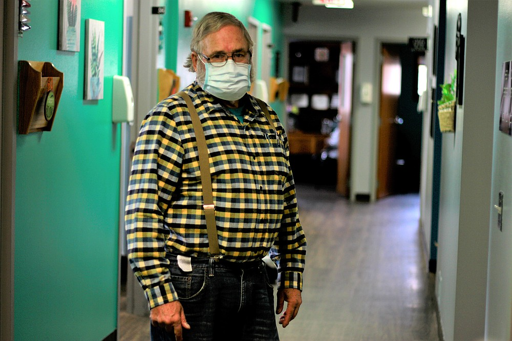 Dr. Tom Dean poses at his clinic in Wessington Springs, S.D., on Friday. Oct. 16, 2020. Dean is one of three doctors in the county, which has seen one of the nation's highest rates of coronavirus cases per person. He writes a column in the local newspaper, the True Dakotan, urging people to take precautions against the virus.(AP Photo/Stephen Groves)