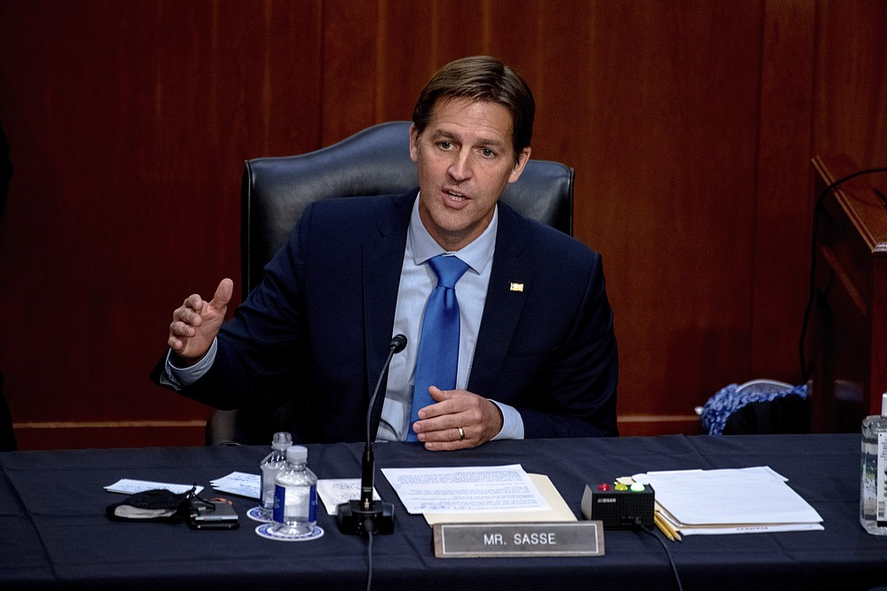 """FILE - In this Oct. 14, 2020 file photo, Sen. Ben Sasse, R-Neb., speaks during the confirmation hearing for Supreme Court nominee Amy Coney Barrett, before the Senate Judiciary Committee on Capitol Hill in Washington. Sen. Sasse told constituents in a telephone town hall meeting that President Donald Trump has """"flirted with white supremacists,"""" mocks Christian evangelicals in private, and """"kisses dictators' butts."""" (Hilary Swift/The New York Times via AP, Pool, File)"""