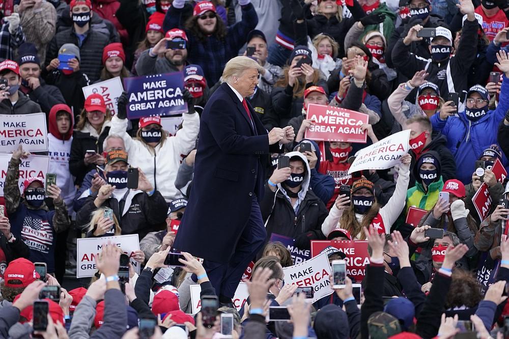 President Donald Trump arrives at a campaign rally, Saturday, Oct. 17, 2020, in Norton Shores, Mich. (AP Photo/Carlos Osorio)