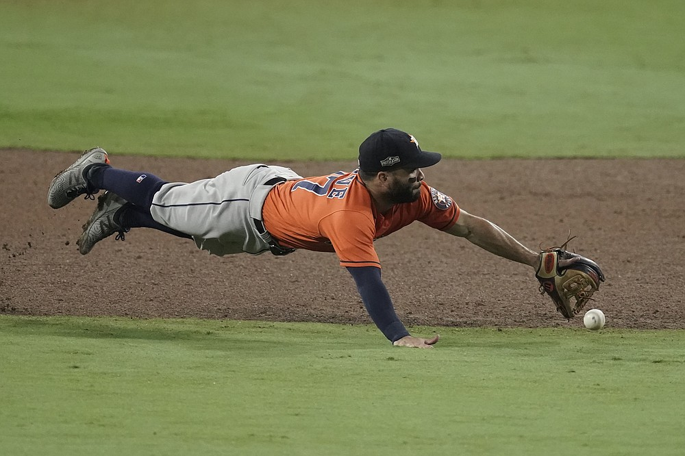Houston Astros second baseman Jose Altuve misses a single by Tampa Bay Rays' Ji-Man Choi during the sixth inning in Game 7 of a baseball American League Championship Series, Saturday, Oct. 17, 2020, in San Diego. (AP Photo/Jae C. Hong)