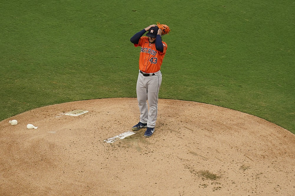 Houstnn Astros starting pitcher Lance McCullers Jr. adjusts his cap during the second inning in Game 7 of a baseball American League Championship Series against the Tampa Bay Rays, Saturday, Oct. 17, 2020, in San Diego. (AP Photo/Gregory Bull)