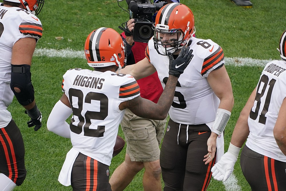Cleveland Browns wide receiver Rashard Higgins (82) celebrates with quarterback Baker Mayfield (6) after the two connected for a touchdown during the first half of an NFL football game against the Pittsburgh Steelers in Pittsburgh, Sunday, Oct. 18, 2020. (AP Photo/Gene J. Puskar)