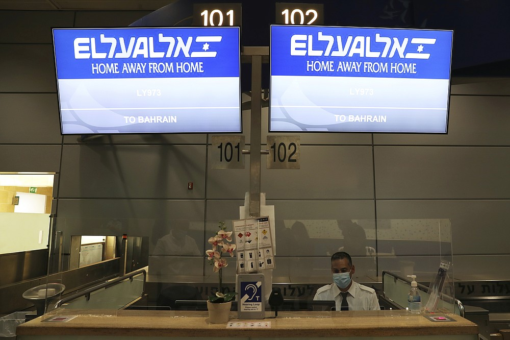 Signs at the counter of Israeli flag carrier El Al shows flight details to Bahrain as Israel is due to send delegates to Bahrain to formalize relations and broaden Gulf cooperation, at Ben Gurion airport in Lod, near Tel Aviv, Israel Sunday, Oct. 18, 2020. (Ronen Zvulun/Pool Photo via AP)