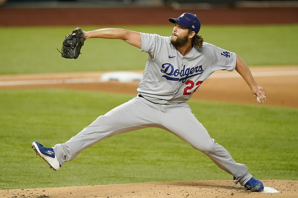 Los Angeles Dodgers starting pitcher Clayton Kershaw throws against the Atlanta Braves during the first inning in Game 4 of a baseball National League Championship Series Thursday, Oct. 15, 2020, in Arlington, Texas. (AP Photo/Eric Gay)