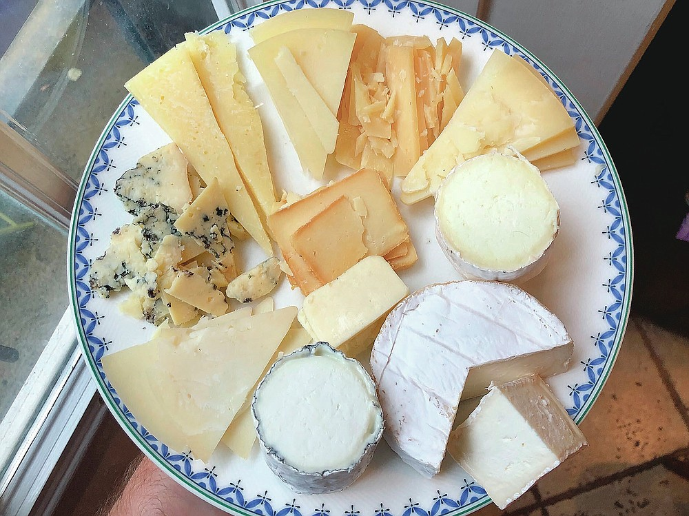 An array cheeses from Goot Essa, an Amish farmstead cheesemaker in Central Pennsylvania, include, clockwise: Der Edel Bleu Kase (far left); Der Alpen Kase, a cow's milk Alpine-style cheese; Der Mutterschaf Kase, a semi-soft sheep's milk Pecorino-style; Butta Schaf Kase, hard sheep's milk Pecorino-style, Felsa Yeh, a firm sheep's milk Manchego-style; Emanuel Vom Tal Kase, a bloomy rind sheep cheese; Der Weichen Gehl, a cow's milk Camembert; Marn Vom Berge Kase, an ash-ripened goat cheese. (Craig LaBan/The Philadelphia Inquirer via AP)