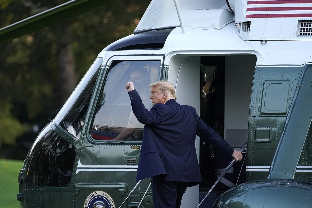 President Donald Trump boards Marine One at the White House in Washington, Tuesday, Oct. 20, 2020, for a short trip to Andrews Air Force Base, Md., and then on to Erie, Pa. for a campaign rally. (AP Photo/Andrew Harnik)