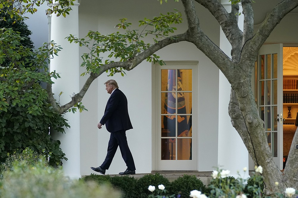 President Donald Trump leaves the Oval Office as he walks to board Marine One at the White House in Washington, Tuesday, Oct. 20, 2020, for a short trip to Andrews Air Force Base, Md., and then on to Erie, Pa. for a campaign rally. (AP Photo/Andrew Harnik)
