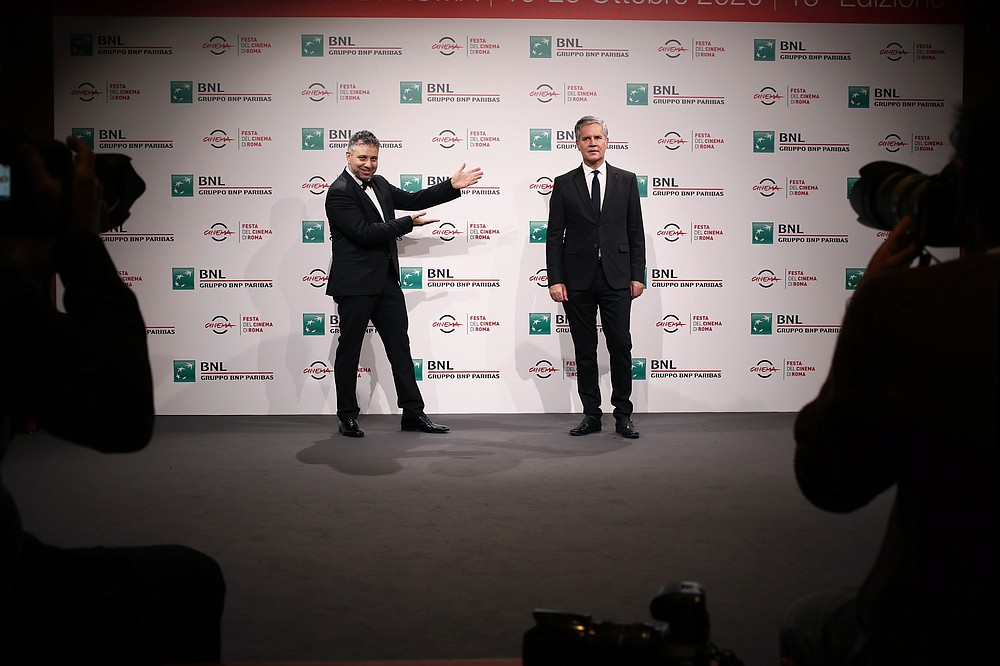 """Director Evgeny Afineevsky, left, and clergy sex abuse survivor and victim's advocate Juan Carlos Cruz, attend the photo call for the movie """"Francesco"""" at the Rome Film Festival, in Rome, Wednesday, Oct. 21, 2020. (AP Photo/Alessandra Tarantino)"""