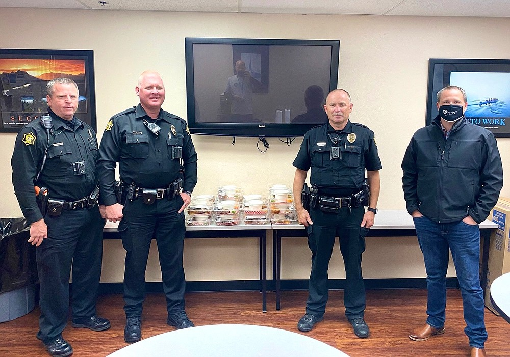 The Springdale Rotary Club makes approximately 50 meal donations each week to essential workers in fire, police, healthcare and senior citizens programs. This donation was made to the Springdale Police Department. Rotarian Randy Herriman is pictured on the right.  (Courtesy photo) (Courtesy Photo)