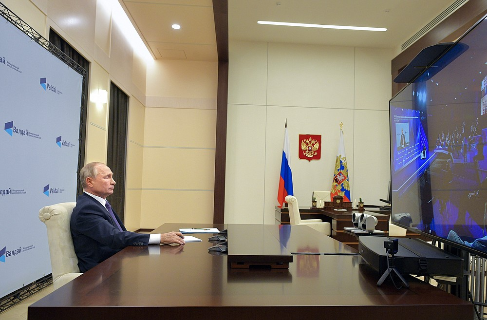 Russian President Vladimir Putin participates in the annual meeting of the Valdai Discussion Club via video conference at the Novo-Ogaryovo residence outside Moscow, Russia, Thursday, Oct. 22, 2020. (Alexei Druzhinin, Sputnik, Kremlin Pool Photo via AP)