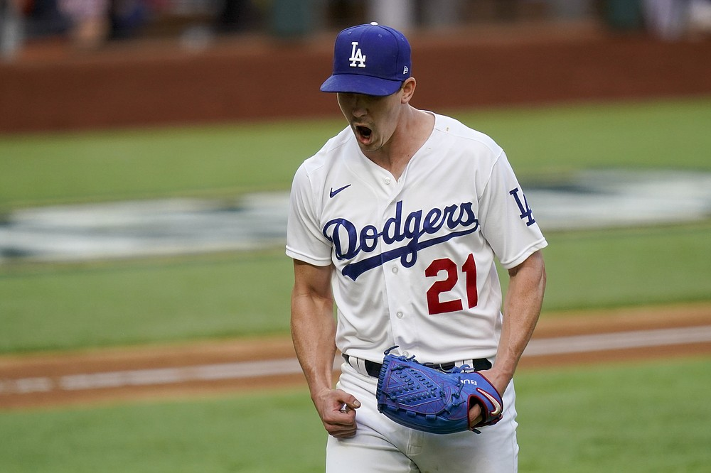 Los Angeles Dodgers starting pitcher Walker Buehler celebrates after striking out Atlanta Braves' Austin Riley during the sixth inning in Game 6 of a baseball National League Championship Series Saturday, Oct. 17, 2020, in Arlington, Texas. (AP Photo/Eric Gay)