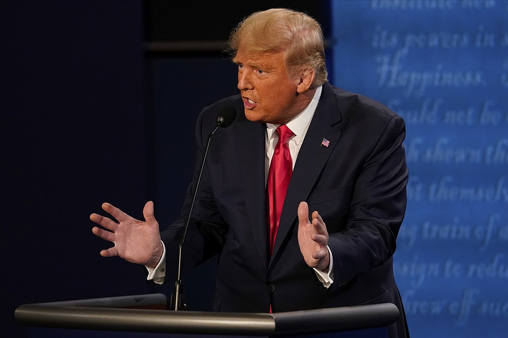 President Donald Trump answers a question during the second and final presidential debate Thursday, Oct. 22, 2020, at Belmont University in Nashville, Tenn. (AP Photo/Morry Gash, Pool)