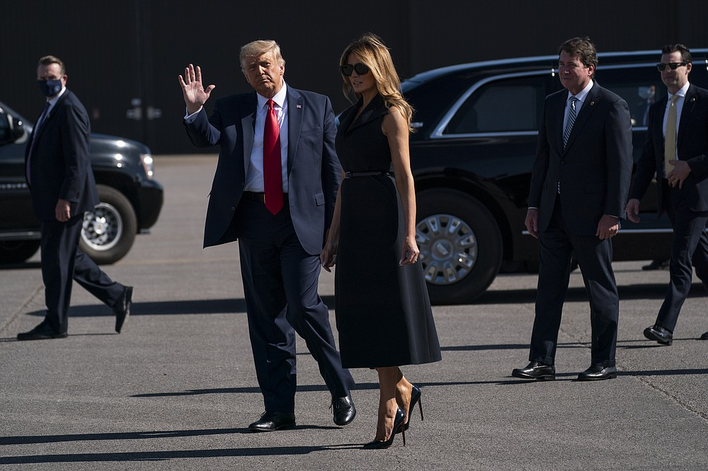 President Donald Trump and first lady Melania Trump arrive at Nashville International Airport ahead of the presidential debate, Thursday, Oct. 22, 2020, in Nashville. (AP Photo/Evan Vucci)
