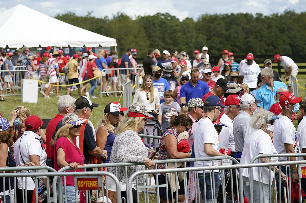 Supporters enter a campaign rally for President Donald Trump Friday, Oct. 23, 2020, in The Villages, Fla. (AP Photo/John Raoux)