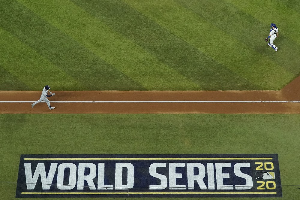Tampa Bay Rays' Brandon Lowe celebrates a two-run home run off Los Angeles Dodgers starting pitcher Dustin May during the fifth inning in Game 2 of the baseball World Series Wednesday, Oct. 21, 2020, in Arlington, Texas. (AP Photo/David J. Phillip)