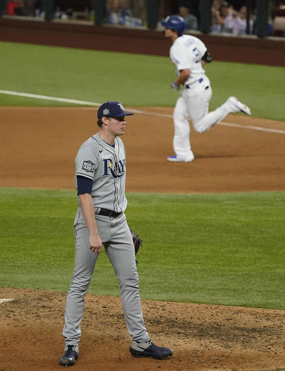 Los Angeles Dodgers' Corey Seager rounds the bases after a home run off Tampa Bay Rays relief pitcher Peter Fairbanks during the eighth inning in Game 2 of the baseball World Series Wednesday, Oct. 21, 2020, in Arlington, Texas. (AP Photo/Tony Gutierrez)