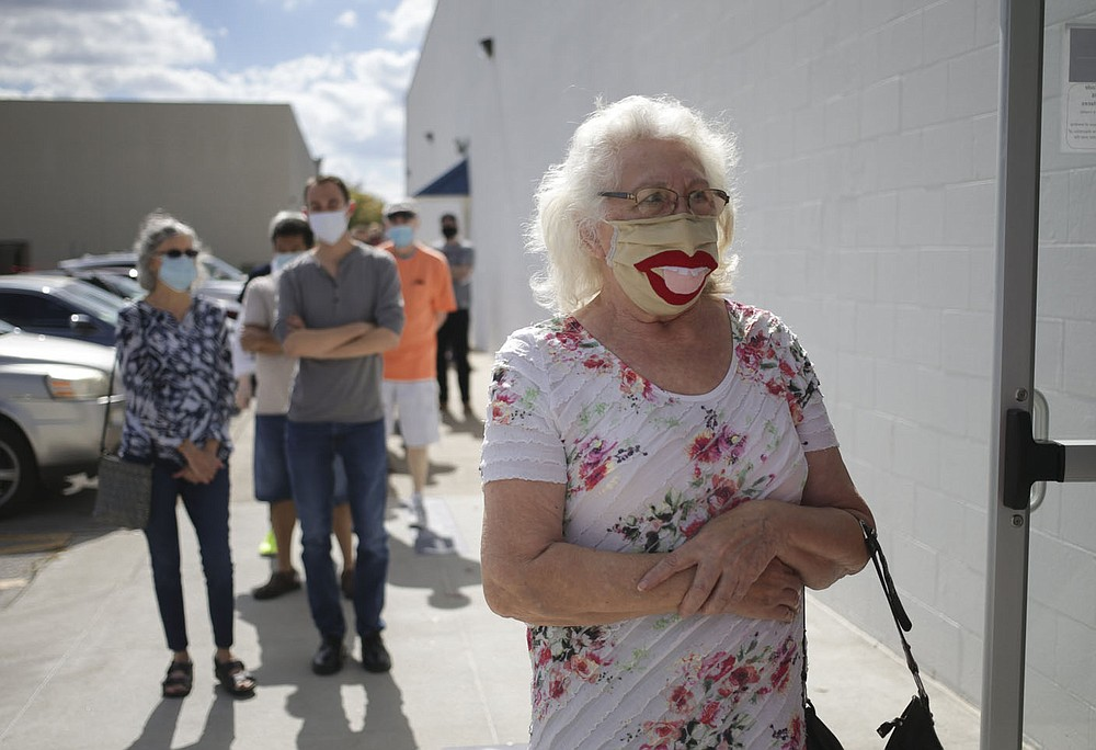 Elva Vanlaningham of Rogers waits in line to vote, Thursday, October 21, 2020 at the Benton County Annex in Rogers. Check out nwaonline.com/201022Daily/ for today's photo gallery.  (NWA Democrat-Gazette/Charlie Kaijo)