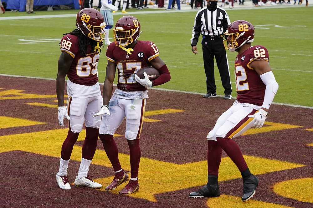 Washington Football Team wide receiver Terry McLaurin (17) celebrates his touchdown with teammates wide receiver Cam Sims (89) and tight end Logan Thomas (82) in the first half of an NFL football game against Dallas Cowboys, Sunday, Oct. 25, 2020, in Landover, Md. (AP Photo/Patrick Semansky)