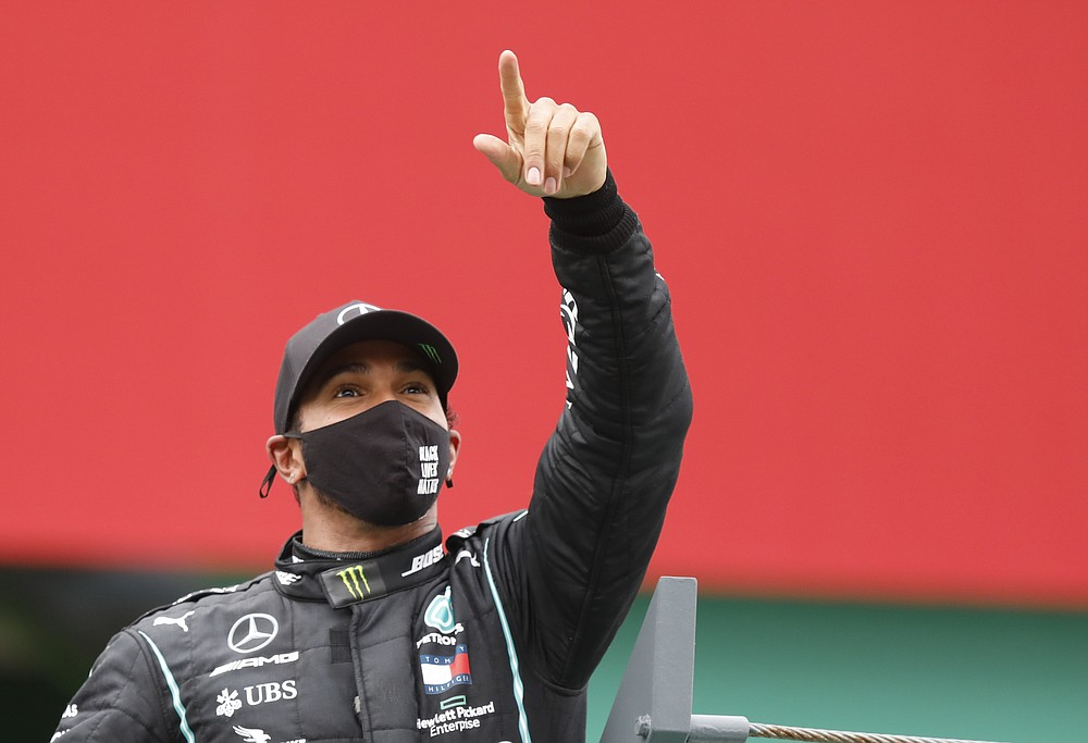 Mercedes driver Lewis Hamilton of Britain celebrates after winning the Formula One Portuguese Grand Prix at the Algarve International Circuit in Portimao, Portugal, Sunday, Oct. 25, 2020. (Rafael Marchante, Pool via AP)