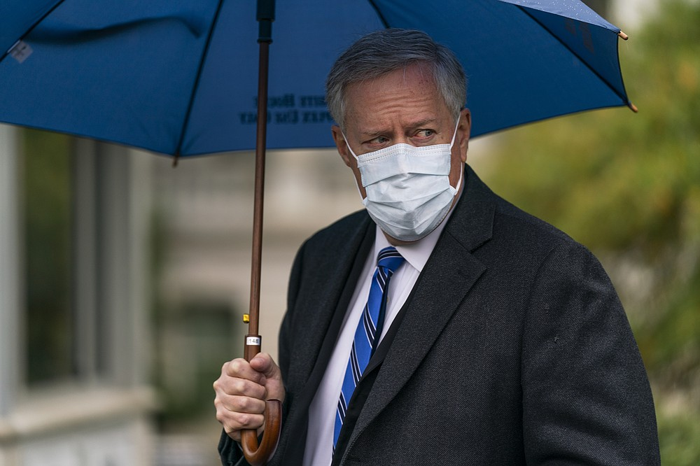 White House chief of staff Mark Meadows responds to reporters questions outside the West Wing on the North Lawn of the White House, Sunday, Oct. 25, 2020, in Washington. (AP Photo/Manuel Balce Ceneta)