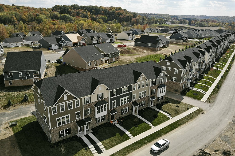 In this image taken with a drone, new townhouses are shown in Valencia, Pa., on Thursday, Oct. 15, 2020. Sales of new homes fell by 3.5% in September to a seasonally-adjusted annual rate of 959,000 million units. The Commerce Department said Monday, Oct. 26, 2020, that despite the modest decrease, sales of new homes are up 32.1% from a year earlier, as the housing market remains strong despite the pandemic. (AP Photo/Ted Shaffrey)