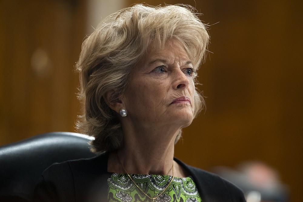 FILE - In this June 23, 2020, file photo Sen. Lisa Murkowski, R-Alaska, listens during a Senate Health, Education, Labor, and Pensions Committee hearing to examine COVID-19 on Capitol Hill in Washington. (Michael Reynolds/Pool via AP, File)