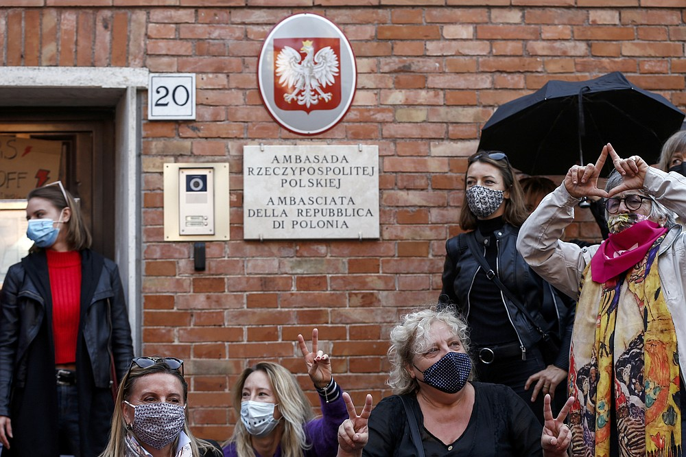 Women stage a protest against the tightening of Poland's already restrictive abortion law, in front of the Polish Embassy in Rome, Wednesday, Oct. 28, 2020. Poland's constitutional court declared that aborting fetuses with congenital defects is unconstitutional. Poland already had one of Europe's most restrictive abortion laws, and the ruling will result in a near-complete ban on abortion. (Cecilia Fabiano/LaPresse via AP)
