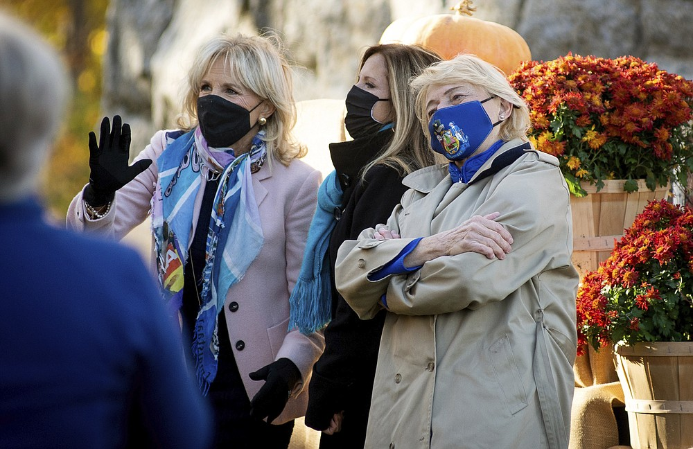 Jill Biden, left, and Governor Janet Mills, right, pose for a photo following a rally on Tuesday, Oct. 27, 2020, in Bangor, Maine. Jill Biden visited Bangor to headline a socially distanced Get Out the Vote rally at the Thomas Hill Standpipe. (Linda Coan O'Kresik/The Bangor Daily News via AP)