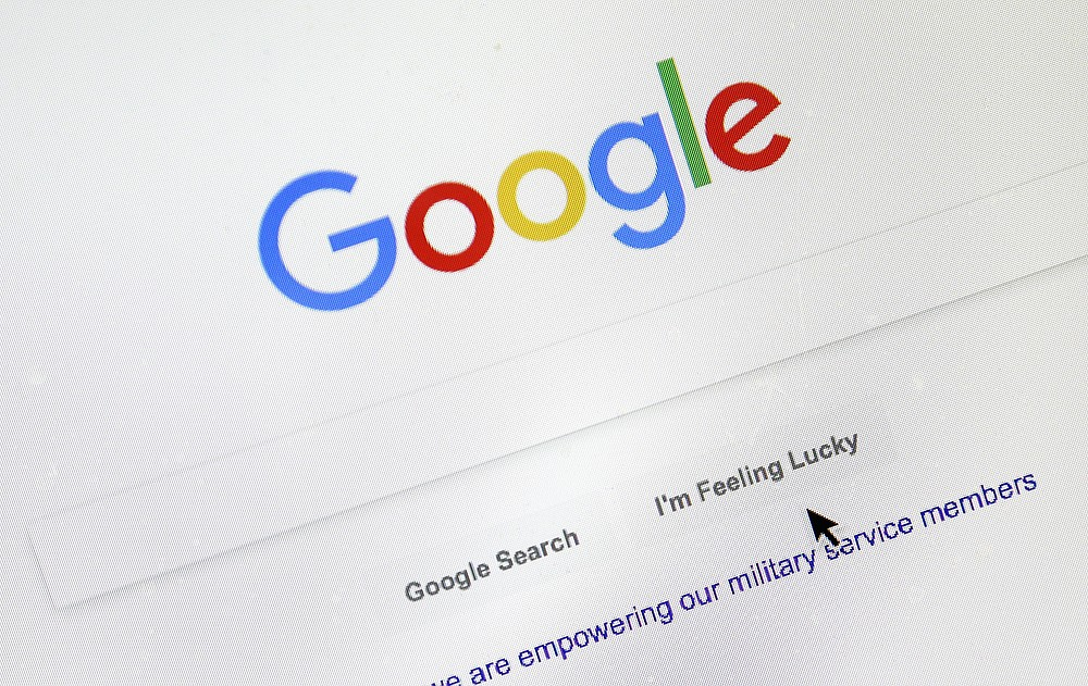 FILE - In this Tuesday, Aug. 28, 2018, file photo, a cursor moves over Google's search engine page, in Portland, Ore. Monopoly or not, small business owners' biggest complaint about Google is that its advertising policies favor companies with big marketing budgets. (AP Photo/Don Ryan, File)